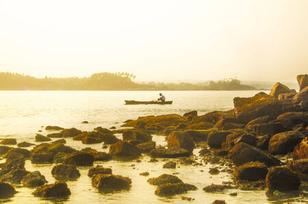 konkan: Local man boating in Palolem Beach, Goa, India