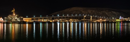 aas: Night view of Tromso Bridge with lights in the city of Tromso in Norway