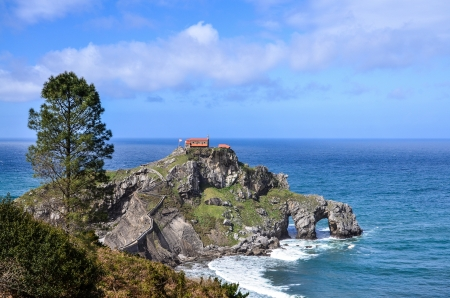 baptist: Panoramic view of the hermitage of San Juan de Gaztelugatxe located on tiny islet on the coast of Biscay in Basque Country  Spain