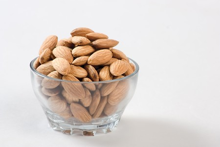 The group of almond against white background  photo