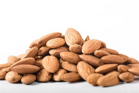 The group of almond against white background