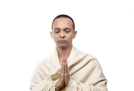 Man looking just like monk with hands in the position of regards photo