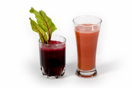 Fresh carrot juice and beetroot juice isolated white background