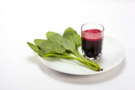 anemia: Fresh spinach  and beetroot juice isolated white background