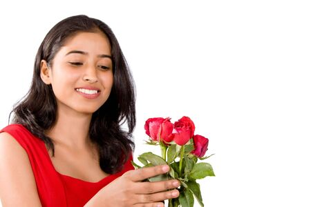 Happy pretty girl with nice red roses photo