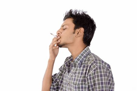 Close-up of an intensively smoking man with heavy smoke photo