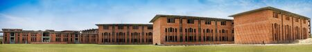 Modern red brick building on college campus  photo