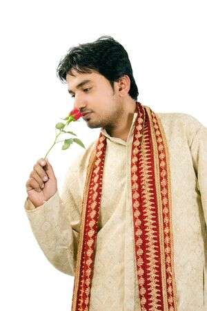 kurta: Young handsome man with red rose