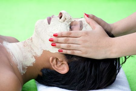Spa facial treatment by a  female assistant  photo