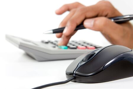 Black computer mouse  and calculator  in white background Stock Photo - 5965575