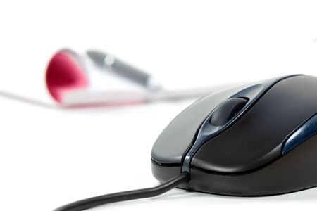 Black computer mouse and writing pad  in background photo