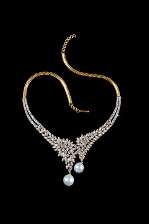 Diamond necklace with pearl pendent over black background  Stock Photo