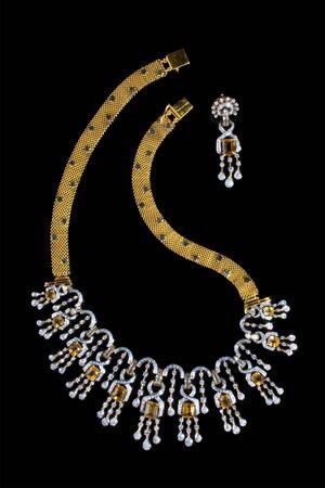 Close up of diamond necklace on black background photo