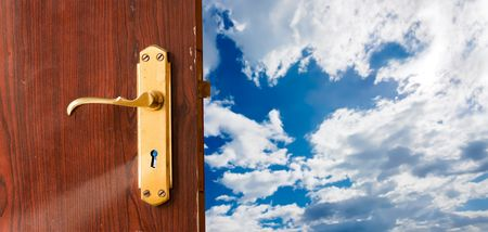 Open door against blue sky; opportunities, new beginning, launch, success, freedom concepts Stock Photo - 6566935