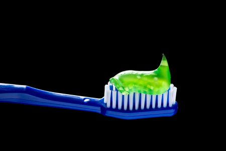 fluoride: Lemon green transparent Toothpaste and toothbrush over black background