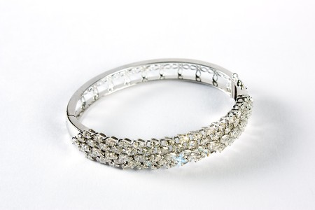 Diamond bracelet with many stones on white background