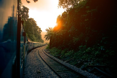 Train on hill in the lap of nature at sunrise