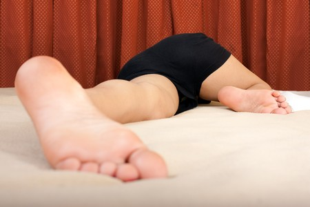 dirty feet: A sleeping young girl with her feet open on bed