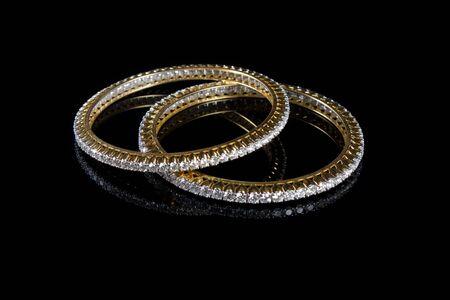 diamond stones: Diamond bracelet with many stones on reflective background