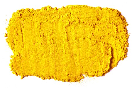 dry powder: Yellow Texture made from turmeric isolated on white background