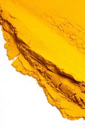 curcuma: Pile of Turmeric powder isolated on a white background
