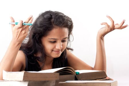 Young indian girl Exited over pile of books