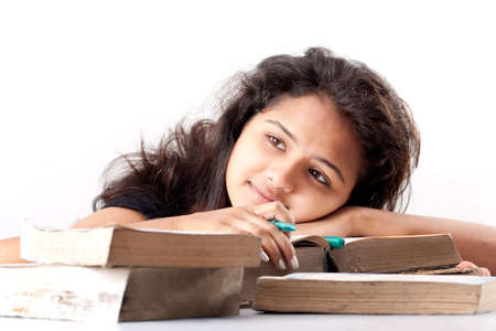 leaned: Young indian girl leaned over pile of books,  Stock Photo