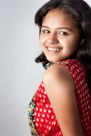 Shy smile of beautiful Indian girl photo