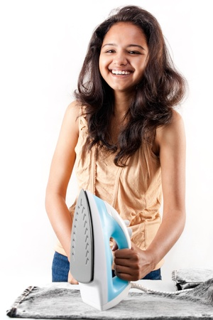 electric iron: Indian girl and electric steam iron Stock Photo