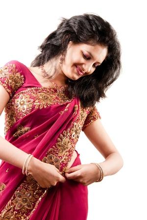 Beautiful Indian happy  woman in pink sari Stock Photo