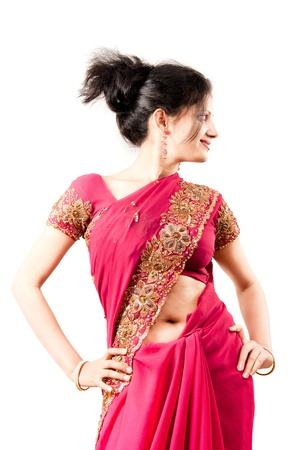 indian fabric: Beautiful Indian happy  woman in pink sari Stock Photo