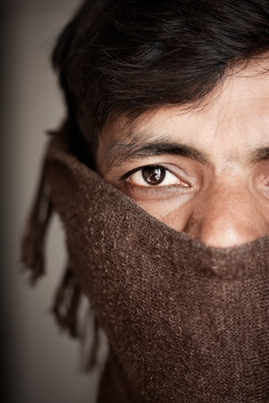 Close-up of an covered face by scarf  of Indian farmer photo