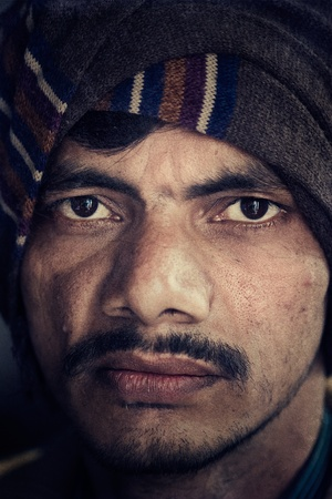 Close-up of an young face of Indian farmer. Grains and textures are added for photo