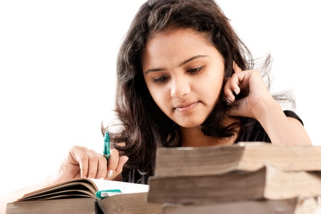leaned: Young indian girl leaned over pile of books, isolated on white