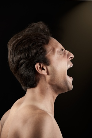 Angry Indian man screaming in extreme rage over black background  Stock Photo - 9821786