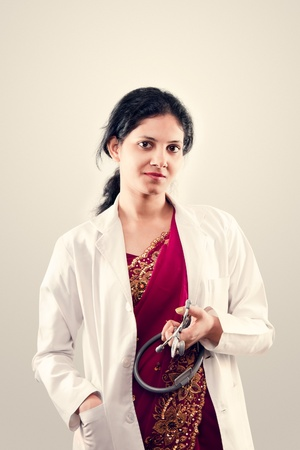Indian beautiful Friendly lady doctor with stethoscope in sari photo