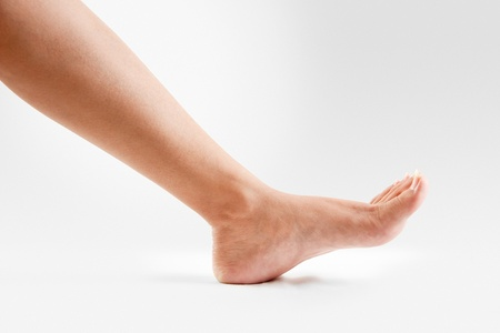 ankles: Female  lower legs with beautiful healthy feet isolated on white background Stock Photo