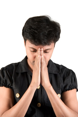 bowed head: Indian man making request, joining his hand and closed eyes Stock Photo