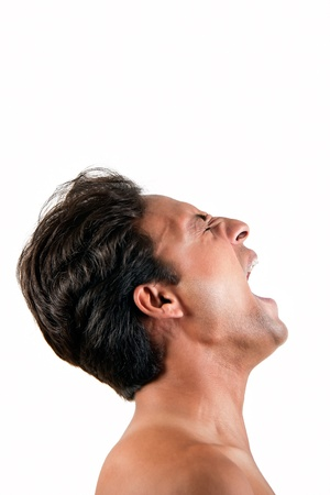 Angry Indian man screaming in extreme rage over white background photo
