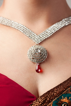Close up of diamond necklace over female body skin photo