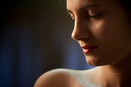High contrast, head and one bare shoulder portrait of a young indian woman.