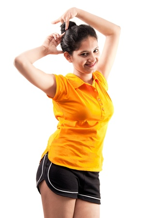 Beautiful happy  Indian girl, isolated on gray background in yellow t-shirt Stock Photo - 10048141