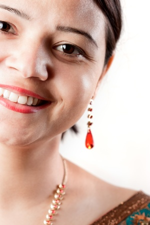 Smiling Indian happy woman over white background photo