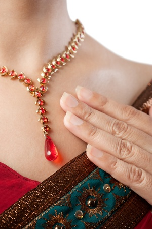 Close up of necklace over female body skin photo