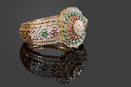diamond stones: Diamond bracelet with many stones on reflective background Stock Photo
