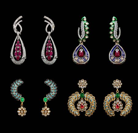 earring: Pairs of Earrings with diamonds isolated over black background