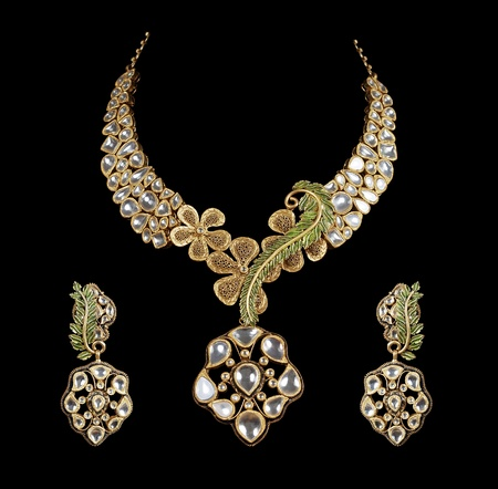 diamond necklace: Close up of diamond necklace with diamond ear ring