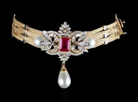 gold necklace: Close up of diamond necklace on black background Stock Photo