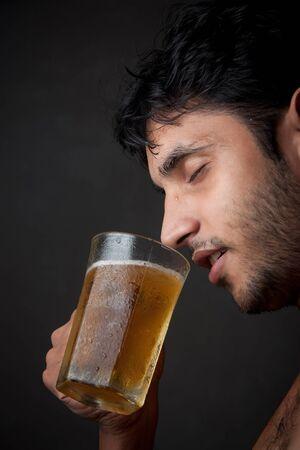 brew beer: Indian Man drinking beer  from beer mug Stock Photo