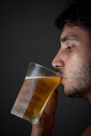 Indian Man drinking beer  from beer mug Stock Photo - 12144236